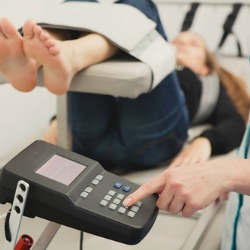 Spinal rehabilitation exercise on young woman. Spinal Decompression Therapy
